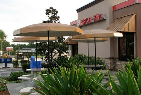 6' Octagonal Umbrellas with Valance installed at Burger King in Beech Nut color